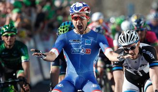 France's Nacer Bouhanni reacts as he crosses the finish line to win the first stage of the Paris-Nice cycling race, in Mantes la Jolie, west of Paris, Sunday, March 9, 2014. (AP Photo/Thibault Camus)