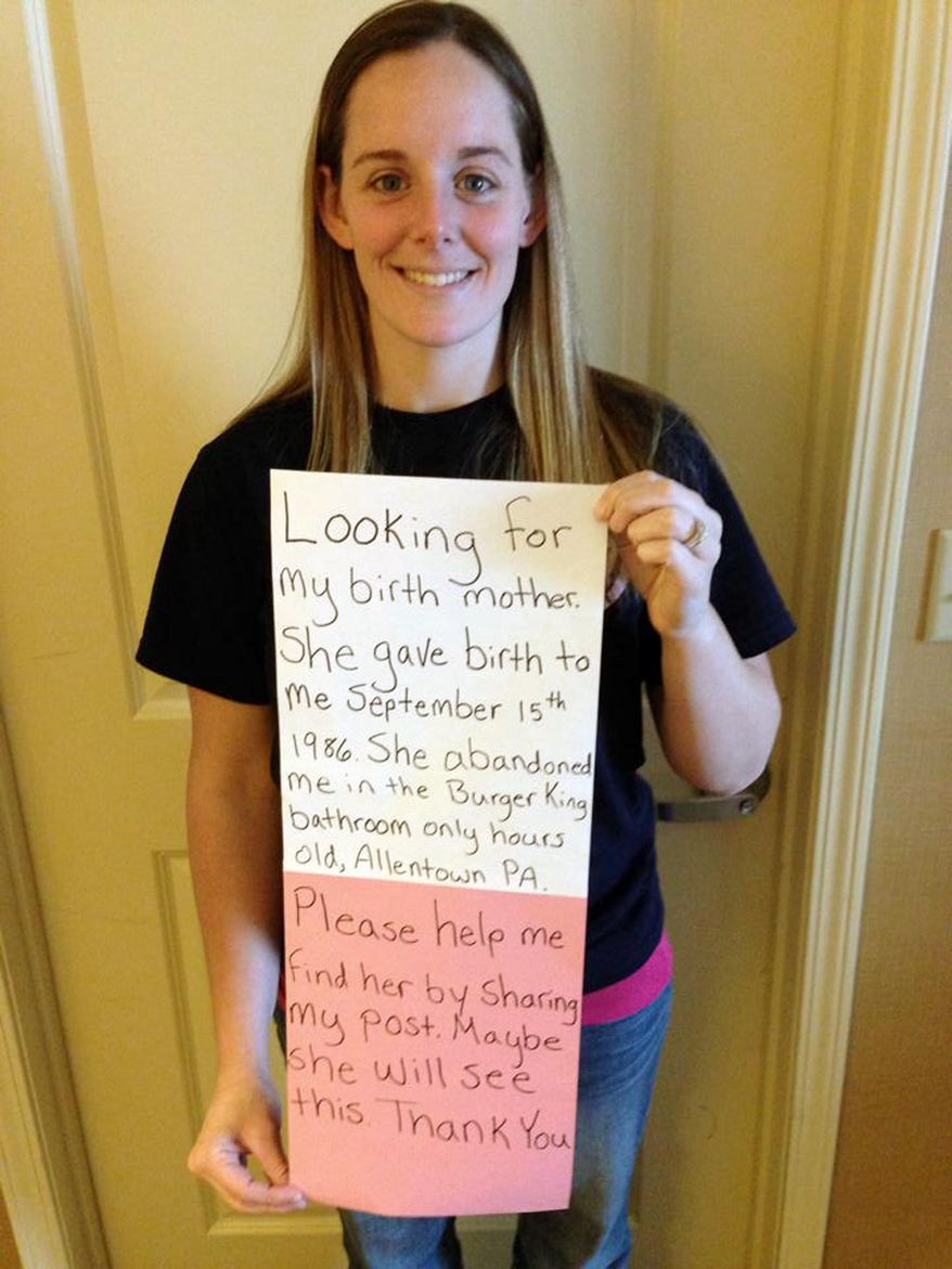 This March 2, 2014, photo provided by Katheryn Deprill that she posted on Facebook, shows her holding a sign that says she is seeking her birth mother. Deprill was abandoned in the bathroom of a Burger King restaurant in Allentown, Pa., when she was a few hours old. (AP Photo/Courtesy of Katheryn Deprill)