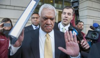 "Jeffrey Thompson holds up his hands to indicate he will not speak to reporters as leaves federal court in Washington, after being charged Monday in a criminal information with two conspiracy offenses stemming from an ongoing investigation Monday, March 10, 2014.  District of Columbia Mayor Vincent Gray was aware of an off-the-books ""shadow campaign"" to support his 2010 bid and personally requested the funds from Thompson, federal prosecutors said Monday. (AP Photo/Cliff Owen)"