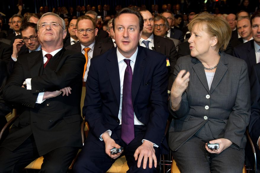 German chancellor Angela Merkel, right, talks with British Prime Minister  David Cameron, center, while Volkswagen CEO, Martin Winterkorn, left, looks on , during the opening ceremony of the CeBIT computer fair in Hannover, Germany, Sunday March 9, 2014.   (AP Photo/dpa,: Swen Pfoertner)