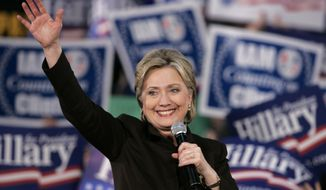 Democratic presidential hopeful Sen. Hillary Rodham Clinton, D-N.Y., addresses a rally Thursday evening, Feb. 7, 2008, in Seattle.  (AP Photo/Elaine Thompson)