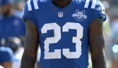 Indianapolis Colts cornerback Vontae Davis (23) walks in front of the bench during the second half of an NFL football game against the Jacksonville Jaguars in Jacksonville, Fla., Sunday, Sept. 29, 2013. (AP Photo/Phelan M. Ebenhack)