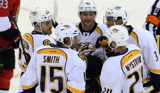 Nashville Predators' Craig Smith (15) celebrates his goal with teammates Colin Wilson (33), Mattias Ekholm (42), Seth Jones (3) and Eric Nystrom (24) during the second period of an NHL hockey game against the Ottawa Senators in Ottawa, Monday, March 10, 2014. (AP Photo/The Canadian Press, Fred Chartrand)