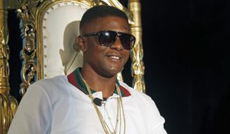 Rapper Lil Boosie, whose real name is Torence Hatch, appears at a news conference in New Orleans, Monday, March 10, 2014. Hatch was released from Louisiana State Penitentiary at Angola where he had been serving an eight-year sentence on drug charges. Lil Boosie says serving prison time in a Louisiana prison was life changing and it's made him a better person and ultimately, he hopes, a better artist. He says he wrote more than 1,000 songs in prison. (AP Photo/Bill Haber)