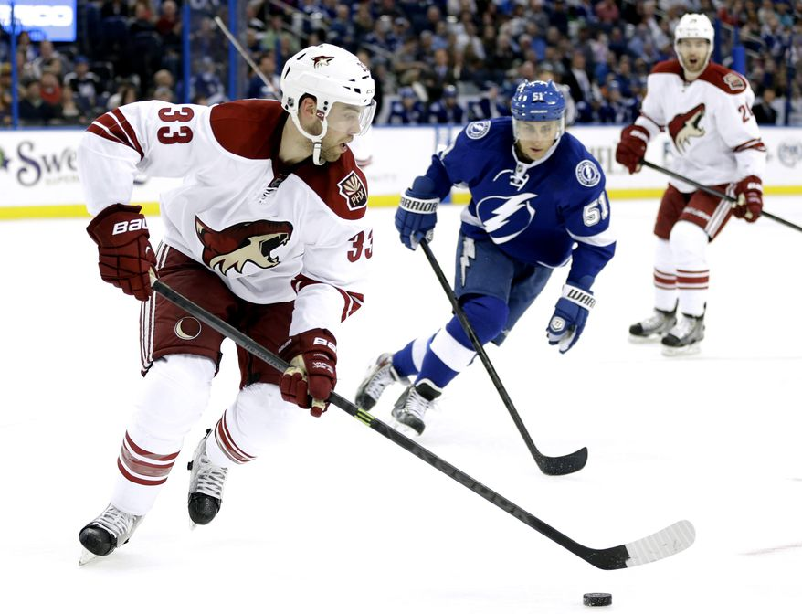 Phoenix Coyotes defenseman Brandon Gormley (33) controls the puck in front of Tampa Bay Lightning center Valtteri Filppula (51), of Finland, during the second period of an NHL hockey game Monday, March 10, 2014, in Tampa, Fla. (AP Photo/Chris O'Meara)