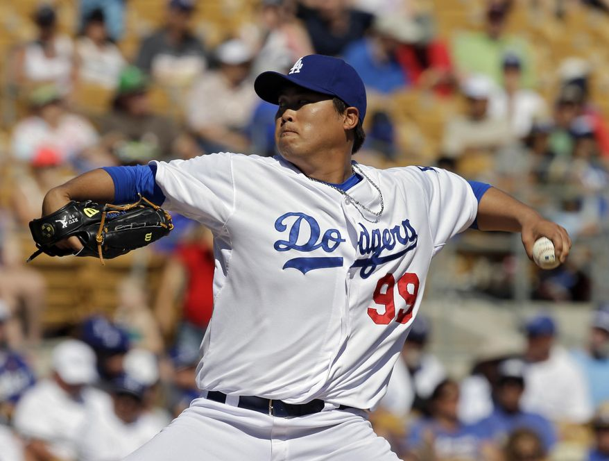 Los Angeles Dodgers starting pitcher Hyun-Jin Ryu, from South Korea, delivers against the Oakland Athletics in the fifth inning of a spring exhibition baseball game, Monday, March 10, 2014, in Glendale, Ariz. (AP Photo/Mark Duncan)