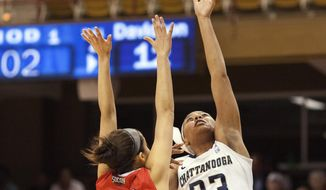 Chattanooga's Tatianna Jackson (33) drives for a layup against Davidson defender Alexandra Long (22) during the first half of the NCAA women's college basketball championship game of the Southern Conference tournament in Asheville, N.C., Monday, March 10, 2014. (AP Photo/Adam Jennings)