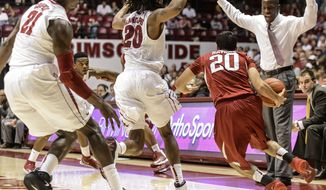 Alabama coach Anthony Grant yells as Alabama collapses on Arkansas guard Kikko Haydar (20) during an NCAA college basketball game Saturday, March 8, 2014, at Coleman Coliseum in Tuscaloosa, Ala. (AP Photo/AL.com, Vasha Hunt) MAGS OUT