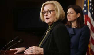 "FILE - This March 6, 2014 file photo shows Sen. Claire McCaskill, D-Mo., left, and Sen. Kelly Ayotte, R-N.H. at a news conference on Capitol Hill in Washington. The Senate is heading toward a vote to change the military justice system to deal with sexual assault. The legislation would scrap the nearly century-old practice of an accused being able to use a ""good soldier defense"" to raise doubts that a crime had been committed. (AP Photo/Charles Dharapak, File)"