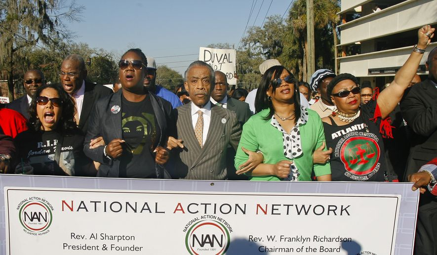 """From left, participants including Lucia McBath, mother of Jordan Davis, Sybrina Fulton, mother of Trayvon Martin, Rev. Al Sharpton, president of National Action Network, and Phyllis Giles, mother of Michael Giles, march to the Florida Capitol Monday, March 10, 2014, in Tallahassee, Fla. Participants were rallying against the state's """"Stand Your Ground"""" laws. (AP Photo/Phil Sears)"""