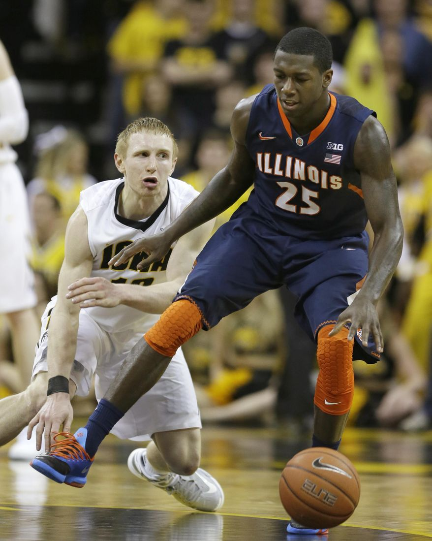 Illinois guard Kendrick Nunn, right, drives past Iowa guard Mike Gesell during the second half of an NCAA college basketball game on Saturday, March 8, 2014, in Iowa City, Iowa. Illinois won 66-63. (AP Photo/Charlie Neibergall)