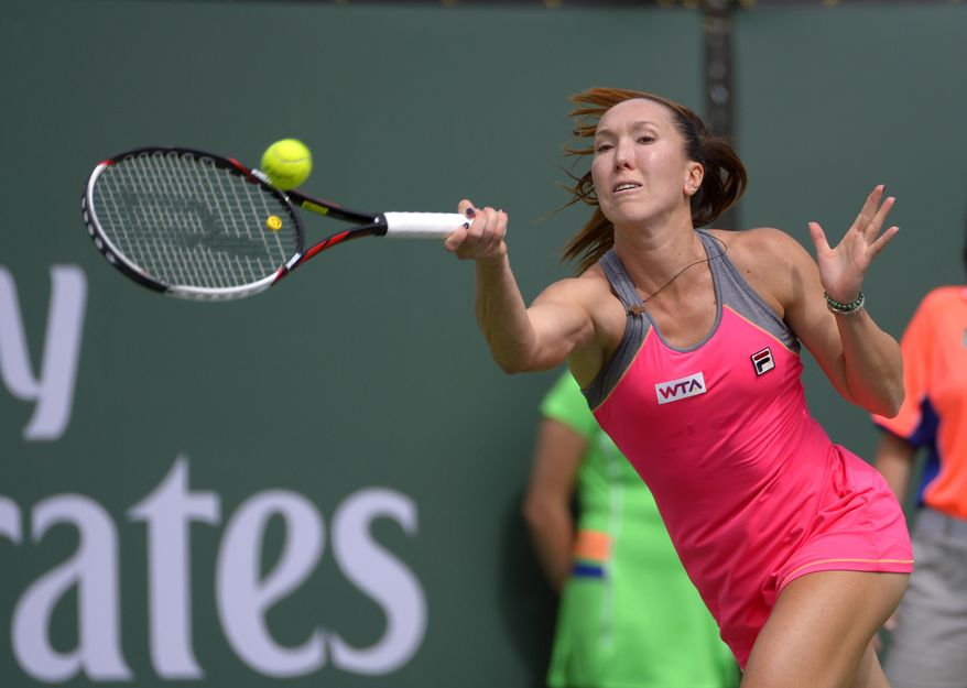 Jelena Jankovic, of Serbia, hits to Caroline Wozniacki, of Denmark, during their fourth round match at the BNP Paribas Open tennis tournament, Tuesday, March 11, 2014, in Indian Wells, Calif. (AP Photo/Mark J. Terrill)