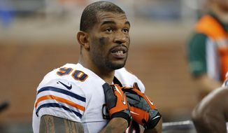 FILE - In this Sept. 29, 2013, file photo, Chicago Bears defensive end Julius Peppers (90) watches from the bench during the fourth quarter of an NFL football game against the Detroit Lions in Detroit. The Bears released eight-time Pro Bowl defensive end Peppers on Tuesday, March 11, 2014. (AP Photo/Paul Sancya, File)