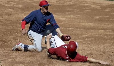 Arizona Diamondbacks's Shelley Duncan, right, spikes Cleveland Indians shortstop Asdrubal Cabrera after getting tagged out stealing second during the third inning of a spring exhibition baseball game in Scottsdale, Ariz., Tuesday, March 11, 2014. (AP Photo/Chris Carlson)