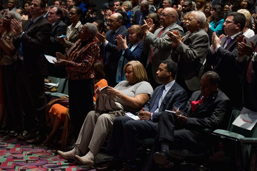"""Councilmember Yvette Alexander (D-Ward 8), center, and Chair Pro Tempore Kenyan McDuffie, center right, sit as supporters applaud Washington, D.C. Mayor Vincent Gray as he gives the 2014 State of the District Address at Kelly Miller Middle School in Northeast a day after federal prosecutors accused Gray of knowing of and personally seeking illegal funs from Jeffrey Thompson do run an illegal """"Shadow Campaign"""" during his run for mayor four years ago, Washington, D.C., Tuesday, March 11, 2014. (Andrew Harnik/The Washington Times)"""