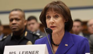 "House Oversight Committee Republicans' new report accuses Lois G. Lerner of ""reckless handling"" of sensitive taxpayer information because she forwarded it from her government account to a private email. (Associated Press)"