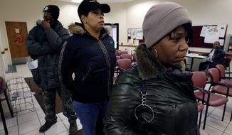 People wait in line at the State of Michigan Wayne County Family Independence Agency office in Detroit for welfare assistance. After a federal judge in Florida struck down the state's drug test requirement in December, some states are pursuing new strategies to link drug testing to welfare. (Associated Press)