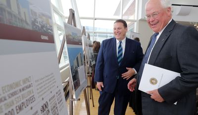 Southwest Michigan First CEO Ron Kitchens and Chief Executive Officer and Chairman of MPI Research William U. Parfet look at artist renderings of the new Western Michigan University Homer Stryker M.D. School of Medicine Tuesday, March 11, 2014, during the unveiling of the school's name  Tuesday, March 11, 2014, in Kalamazoo, Mich. (AP Photo/Kalamazoo Gazette-MLive Media Group, Mark Bugnaski) ALL LOCAL TV OUT; LOCAL TV INTERNET OUT