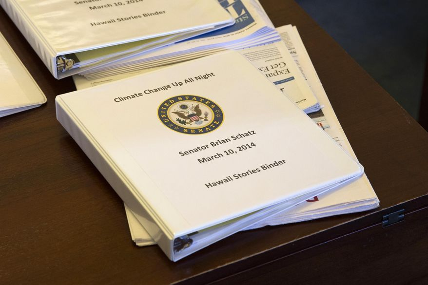 A binder containing climate change talking points and information for Sen. Brian Schatz, D-Hawaii, sits on a desk before a meeting of the Senate Climate Action Task Force prior to taking to the Senate Floor all night to urge action on climate change on Monday, March 10, 2014, in Washington. (Associated Press) **FILE**