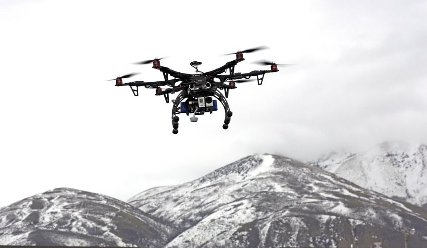 In this Feb. 13, 2014, photo, members of the Box Elder County Sheriff's Office fly their search and rescue drone during a demonstration, in Brigham City, Utah. Law enforcement, government agencies and others are itching to use drones for everything from finding lost hikers to tracking shifting wildfires. But privacy watchdogs are urging state legislatures to step in and head off any potential privacy violations. That tension is on display as more than 35 states consider drone legislation this year, according to the National Conference of State Legislatures. The bills include ways to attract an industry that could generate billions and restrictions on drone use and data collection. (AP Photo/Rick Bowmer)