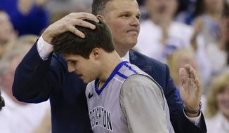 Creighton coach Greg McDermott pats his son Doug McDermott, who leaves the NCAA college basketball game in the closing minutes in Omaha, Neb., Saturday, March 8, 2014. Doug McDermott scored a career-high 45 points and became the eighth player in Division I history to go over 3,000 for a career, and No. 13 Creighton rolled to an 88-73 victory over Providence. (AP Photo/Nati Harnik)