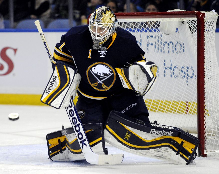 Buffalo Sabres goaltender Jhonas Enroth, of Sweden, watches an incoming shot during the second period of an NHL hockey game against the Nashville Predators in Buffalo, N.Y., Tuesday, March 11, 2014. (AP Photo/Gary Wiepert)