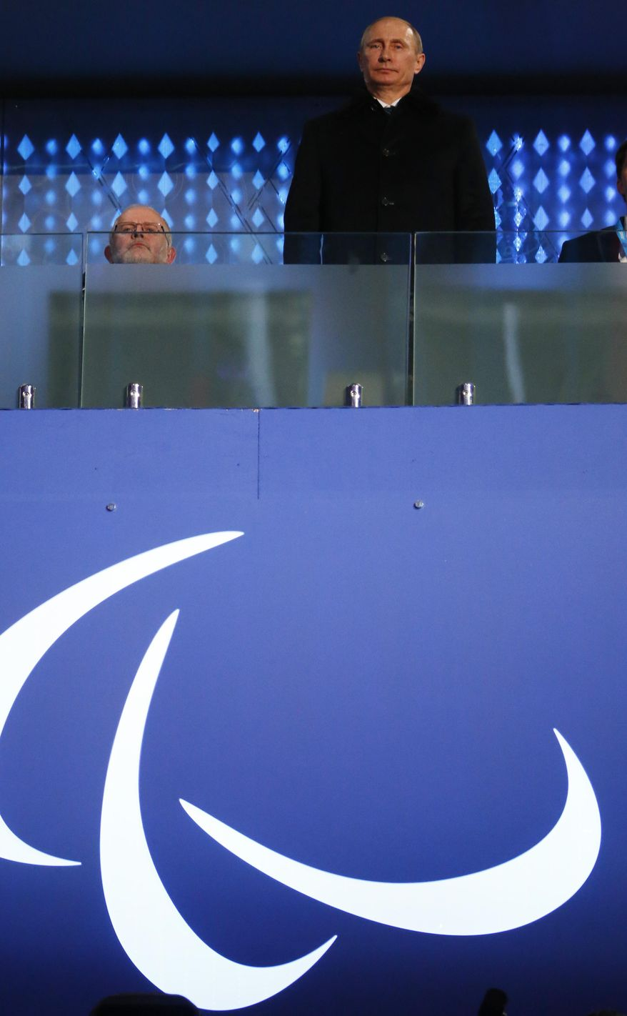 Russian President Vladimir Putin, right, and Sir Philip Craven, President of the International Paralympic Committee attend the opening ceremony of the 2014 Winter Paralympics at the Fisht Olympic stadium  in Sochi, Russia, Friday, March 7, 2014.  (AP Photo/Dmitry Lovetsky)
