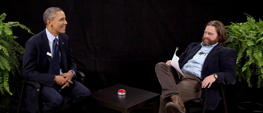 """This image from video released by Funny Or Die shows President Obama, left, with actor-comedian Zach Galifianakis during an appearance on """"Between Two Ferns,"""" the digital short with a laser focus on reaching people aged 18 to 34. The president urged young people to sign up for the new health care plan through an appearance posted Tuesday, March 11, 2014, on the comic website Funny or Die, bypassing TV talk show titans like Jimmy Fallon or Jimmy Kimmel for an online audience. (AP Photo/Funny Or Die)"""