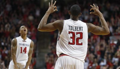 Texas Tech's Jordan Tolbert (32) celebrates a 3- point basket near teammate Robert Turner (14) during an NCAA college basketball game against Texas in Lubbock, Texas, Saturday, March 8, 2014. (AP Photo/Lubbock Avalanche-Journal, Zach Long) LOCAL TV OUT