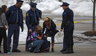 Skye Cieszlak, girlfriend of missing Saginaw Spirit hockey player Terry Trafford, is comforted after collapsing in the parking lot of the Saginaw Township Wal-Mart, Tuesday, March 11, 2014. Police found a 1995 GMC Sierra that matches the description of Terry Trafford's vehicle. Police found a body in the truck but have not yet identified the person. (AP Photo/The Saginaw News, Neil Barris)