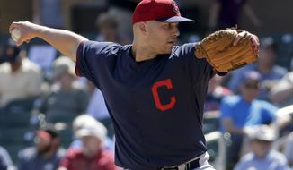 Cleveland Indians starting pitcher Justin Masterson throws to an Arizona Diamondbacks batter during the first inning of an exhibition baseball game in Scottsdale, Ariz., Tuesday, March 11, 2014. (AP Photo/Chris Carlson)