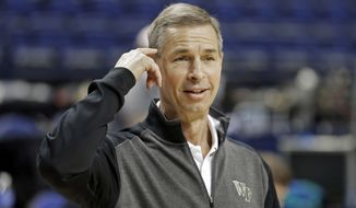 Wake Forest head coach Jeff Bzdelik watches his team during an NCAA college basketball practice for the Atlantic Coast Conference tournament in Greensboro, N.C., Tuesday, March 11, 2014. Wake Forest plays Notre Dame in a first round game on Wednesday. (AP Photo/Chuck Burton)