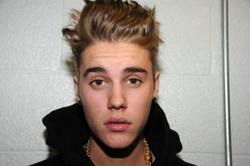 ** FILE ** This Jan. 23, 2014, file photo made available by the Miami Beach Police Department, shows Justin Bieber at the police station in Miami Beach, Fla. (AP Photo/Miami Beach Police Department, File)