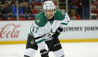 **FILE** Dallas Stars center Rich Peverley (17) waits for face-off against the Detroit Red Wings in the first period of an NHL hockey game in Detroit Thursday, Nov. 7, 2013. (AP Photo/Paul Sancya)