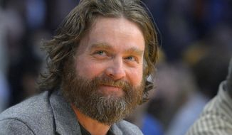 "FILE - In this Feb. 28, 2013 file photo, actor Zach Galifianakis watches the Los Angeles Lakers play the Minnesota Timberwolves in their NBA basketball game in Los Angeles. President Barack Obama is hamming it up online to promote his health care plan. Obama joked Tuesday with Galifianakis, including poking fun at the poorly reviewed ""Hangover Part III"" during an interview on thhe website Funny or Die.  (AP Photo/Mark J. Terrill, File)"