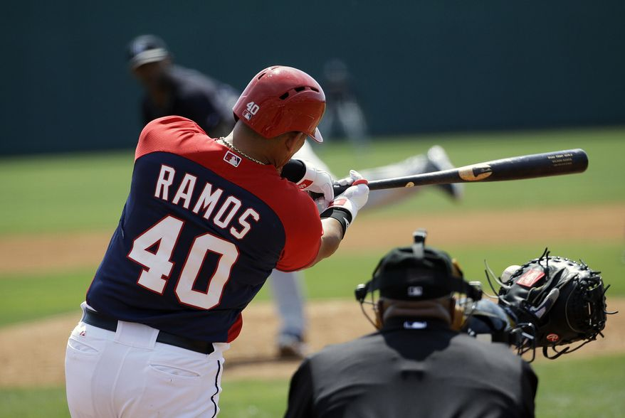Washington Nationals' Wilson Ramos grounds into a force out to score teammate Anthony Rendon in the first inning of an exhibition spring training baseball game against the New York Yankees, Tuesday, March 11, 2014, in Viera, Fla. (AP Photo/David Goldman)