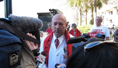 Nurse David Ball talks to reporters about why he planned to get a ticket as he protests South Carolina's decision not to accept federal money to expand Medicaid on Tuesday, March 11, 2014, in Columbia, S.C. This is the second week Truthful Tuesday protesters have blocked the road into the Statehouse garage. (AP Photo/Jeffrey Collins)