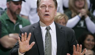 Michigan State coach Tom Izzo gives instructions during the first half of an NCAA college basketball game against Iowa, Thursday, March 6, 2014, in East Lansing, Mich. Michigan State won 86-76. (AP Photo/Al Goldis)