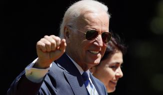 ** FILE ** Vice President Joseph R. Biden walks through the Cerro Castillo palace gardens on his way to having lunch with Chile's newly sworn-in President Michelle Bachelet, in Vina del Mar, Chile, Tuesday, March 11, 2014. (AP Photo/Luis Hidalgo)