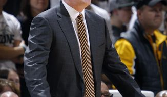 Iowa coach Fran McCaffery gives instructions during the second half of an NCAA college basketball game against Michigan State, Thursday, March 6, 2014, in East Lansing, Mich. Michigan State won 86-76. (AP Photo/Al Goldis)