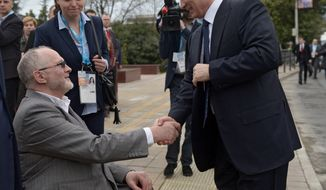 Russian President Vladimir Putin, right,  shakes hands with International Paralympic Committee President Philip Craven while visiting city facilities in Sochi, Russia, Friday, March 7, 2014. The opening ceremony of the 2014 Winter Paralympics is held in Sochi on Friday. (AP Photo/RIA-Novosti, Alexei Nikolsky, Presidential Press Service)