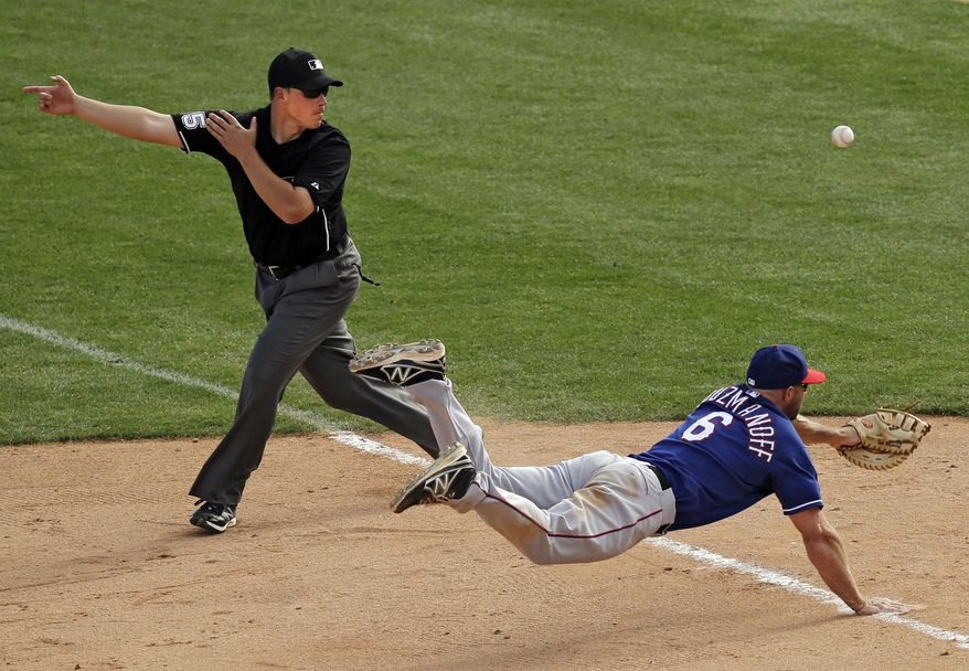Texas Rangers first baseman Kevin Kouzmanoff (6) can't catch a single by Chicago White Sox's Alex Liddi to drive in the winning run in the ninth inning of a spring exhibition baseball game Tuesday, March 11, 2014, in Glendale, Ariz. The White Sox won 7-6. (AP Photo/Mark Duncan)