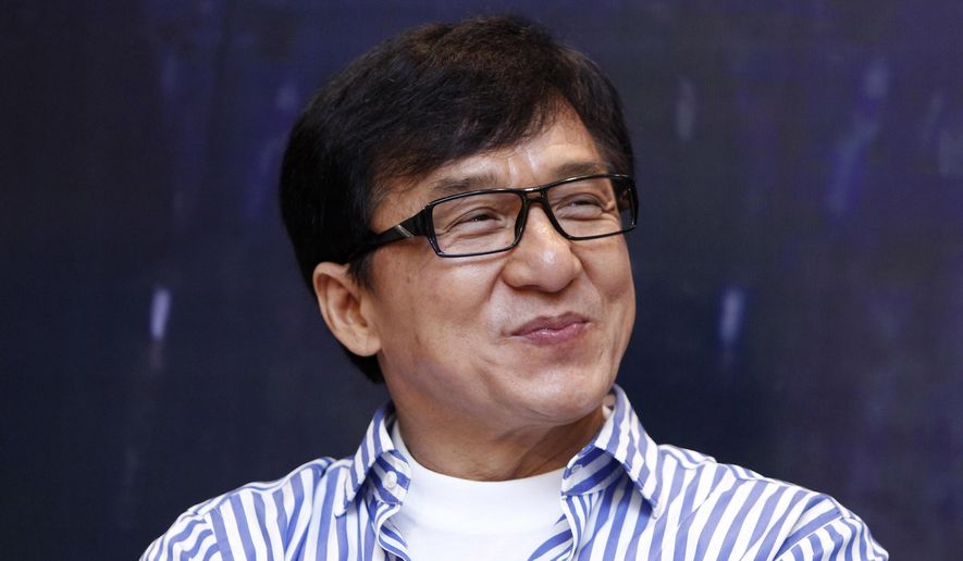 "This Dec. 18, 2013 file photo shows Hong Kong actor Jackie Chan smiles during a press conference to promote his new film ""Police Story 2013"" in Kuala Lumpur, Malaysia. (AP Photo/Lai Seng Sin, File)"