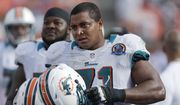 Miami Dolphins tackle Jonathan Martin (71) stands on the sidelines during the Dolphins' NFL football game against the Jacksonville Jaguars in Miami, Dec. 16, 2012. (AP Photo/Wilfredo Lee) ** FILE **