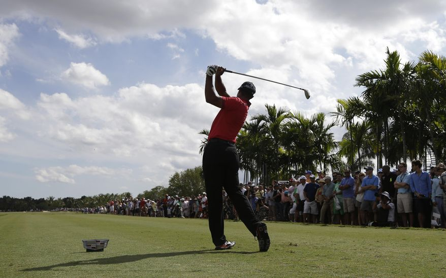 Tiger Woods hits from the sixth tee during the final round of the Cadillac Championship golf tournament on Sunday, March 9, 2014, in Doral, Fla. (AP Photo/Lynne Sladky)