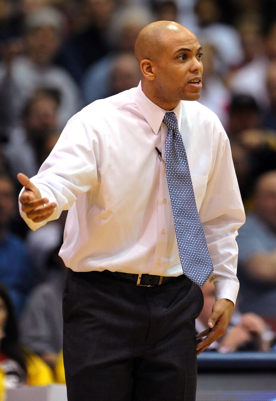 Mount St. Mary's head coach Jamion Christian talks with an official during the second half of the Northeastern Conference championship NCAA college basketball game against Robert Morris on Tuesday, March 11, 2014, in Coraopolis, Pa. Mt. Saint Mary won 88-71.(AP Photo/Don Wright)