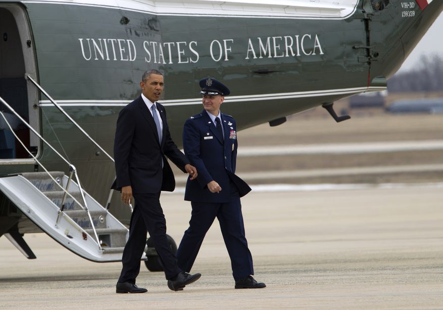 President Barack Obama is escorted by Col. William M. Knight,  Commander of the 11th Wing, upon his arrival aboard the Marine One helicopter at Andrews Air Force Base in Md., Tuesday March. 11,  2014,. Obama is traveling to New York for a pair of fundraisers for the Democrats. ( AP Photo/Jose Luis Magana)