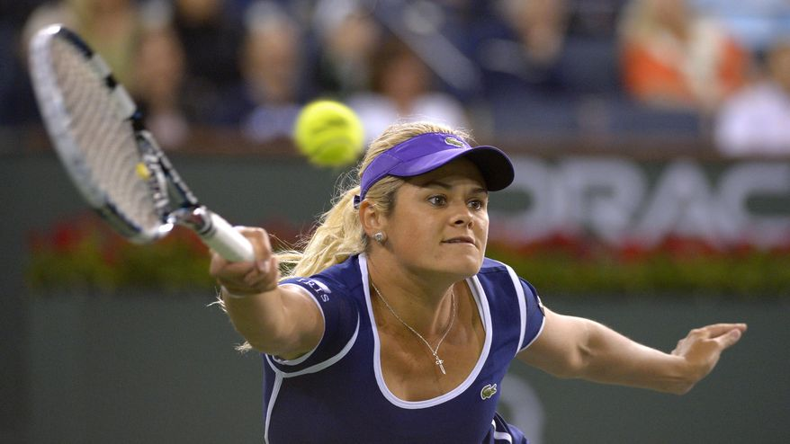 Aleksandra Wozniak, of Canada, returns a shot to Li Na, of China, at the BNP Paribas Open tennis tournament, Tuesday, March 11, 2014, in Indian Wells, Calif. (AP Photo/Mark J. Terrill)