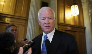 ** FILE ** Sen. Saxby Chambliss, Georgia Republican. (Associated Press photographs)