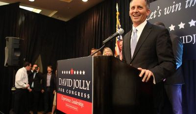 Republican David W. Jolly won Tuesday in a Florida congressional race in an election emblematic of the new reality of money in politics. (Associated Press)